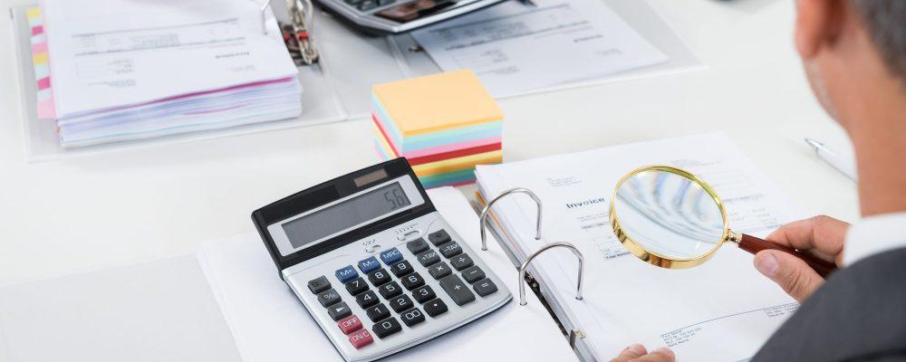 Businesspeople Scrutinizing Bills
